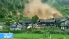 Dramatic footage shows moment landslide sweeps houses away in China