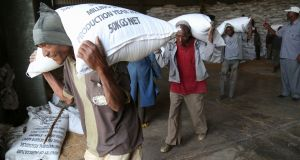 Workers move sacks of emergency food supplies in and out of Ethiopia's largest 'strategic grain reserve' depot in Adama, on February 13, 2016. Ethiopia is in the grip of an El Nino drought with 10.2 million people - 10 per cent of the population - needing food aid. (Photo credit  COLIN COSIER/AFP/Getty Images)