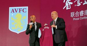 Aston Villa CEO Keith Wyness (right) and new manager Roberto Di Matteo at a news conference in Beijing, China. Photograph: Reuters/Jason Lee