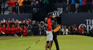 Henrik Stenson of Sweden celebrates victory with caddie Garath Lord after the winning putt at Royal Troon. Photograph: Mike Ehrmann/Getty Images