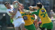 Tyrone's Seán Cavanagh under pressure from the Donegal defence. He guided his team to the Ulster title in Clones with some inspirational late points. Photograph: INPHO/Lorraine O'Sullivan