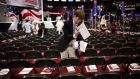 A volunteer places programmes on chairs before the start of the Republican National Convention in Cleveland, Ohio, US. Photograph: John Taggart/Bloomberg