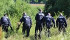 Police officers search for evidence near Würzburg, Germany, following a train attack. Photograph: Josef Hildenbrand/EPA