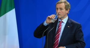Taoiseach Enda Kenny drinks a glass of water during a news conference at the Chancellery in Berlin, Germany, last week. Mr Kenny said German chancellor Angela Merkel is 'clearly aware of our situation' with regard to the Border with Northern Ireland and the post-Brexit relationship with EU. Photographer: Bloomberg