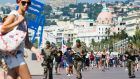 French soldiers patrol the Promenade des Anglais in the French riviera city of Nice on Tuesday after the deadly attack on Bastille day killed 84 people. Photograph: Olivier Anrigo/EPA