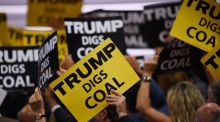 Signs supporting Republican presidential candidate Donald Trump are held during the Republican National Convention in Cleveland, Ohio. Photograph: Timothy A Clary/AFP/Getty Images
