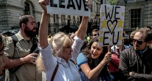 "A ""Leave"" campaigner and a supporter of ""Remain"" during demonstrations over the Brexit vote in London, July 2, 2016. Photograph: Andrew Testa/The New York Times"