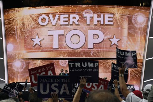 "A screen reading ""Over The Top"" is displayed as Donald Trump, presumptive 2016 Republican presidential nominee, receives the number of votes needed to secure the party's nomination during the Republican National Convention (RNC) in Cleveland, Ohio, U.S., on Tuesday, July 19, 2016. Photograph : David Paul Morris/Bloomberg"