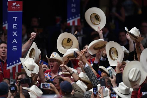 Delegates cheer during the second day of the Republican National Convention on July 19, 2016 at the Quicken Loans Arena in Cleveland, Ohio. The convention nominated Donald Trump for president. AFP PHOTO / JIM WATSONJIM WATSON/AFP/Getty Images