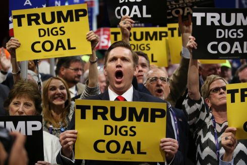 Attendees hold signs supporting Donald Trump and coal on day two of the Republican National Convention at the Quicken Loans Arena in Cleveland in Cleveland, July 19th.  Photograph: Damon Winter/The New York Times