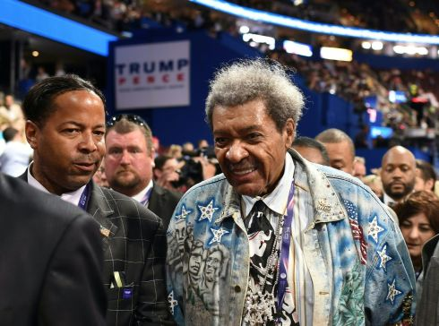 Former boxing promoter Don King is seen on the second day of the Republican National Convention on July 19, 2016 (2nd R) listen to a speaker during the second day of the Republican National Convention at the Quicken Loans Arena in Cleveland, Ohio.  AFP PHOTO / Robyn BECK