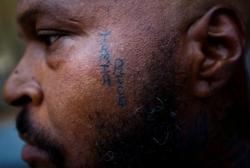 Stevedore Crawford Jr., of Delaware, Ohio, shows his tattoo, in memory of the Tamir Rice shooting, on a street near the Republican National Convention in Cleveland, Ohio, USA, 19 July 2016. According to reports, police shot Tamir Rice in the chest near the city's Cudell Recreation Center on 22 November, when he reached into his waistband for a gun that turned out to be a fake.  EPA/JUSTIN LANE