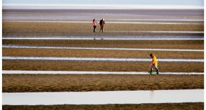 Horizontal lines and space draw you into the picture taken on Sandymount Strand Dublin. Photograph: Bryan O'Brien