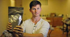 Soylent founder Rob Rhinehart holds a bag of his food substitute powder. Photograph: Josh Edelson/AFP/Getty Images