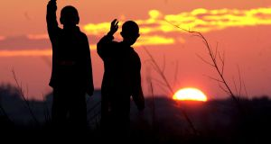 Two seperate silhouettes against the setting sun creates a simple but strong sunset picture on the Knock-Claremorris Bypass. Photograph: Eric Luke/ The Irish Times
