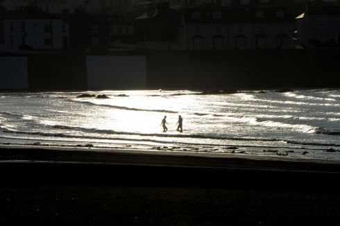 Shooting into the light on the beach sea front at Kilkee, Co. Clare. Photograph: Alan Betson / The Irish Times