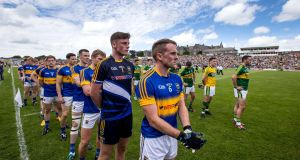"Tipperary captain Peter Acheson prepares to lead the team  at the Munster final against Kerry. ""Most of Kerry's scores came from our mistakes – eradicating them is the main thing.""  Photograph: Cathal Noonan/Inpho"
