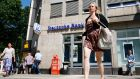 A woman walking in front of a branch of Germany's Deutsche Bank in Cologne. Photograph: Reuters/Wolfgang Rattay
