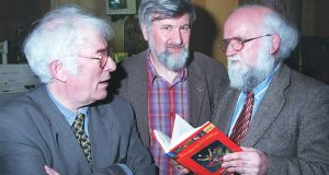 Robert Dunbar at the launch of his book, Enchanted Journeys, in the National Museum with Seamus Heaney and publisher Michael O'Brien. Photograph: Joey Cleary