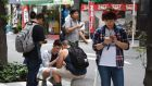 Pokemon Go players at Akihabara shopping district in Tokyo on Friday. Photograph: Toru Yamanakatoru/AFP/Getty