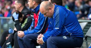 Waterford manager Derek McGrath bows his head in dejection  near the end of his side's Munster senior hurling final hammering by Tipperary in Limerick two weeks ago.  Photograph: Ryan Byrne/Inpho