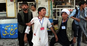 People help an injured victim after a suicide bomb targeted a demonstration of Hazara minority in Kabul, Afghanistan. Photograph: Hedayatullah Amid/EPA