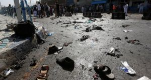 The shoes of victims are seen at the site of the blast in Kabul, Afghanistan. Photograph: Omar Sobhan/Reuters