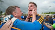 Tipperary manager Liam Kearns celebrates with Evan Comerford after beating Derry. Photograph: Morgan Treacy/Inpho