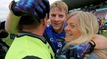 Clare's Podge Collins celebrates with his father and team manager Colm and his mother Katherine after Saturday's win over Roscommon. Photograph: Donall Farmer/Inpho