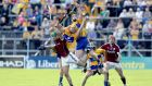 Clare's Tony Kelly and Colm Galvin with David Burke of Galway. Photograph: Morgan Treacy/Inpho