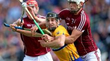 Clare's John Conlon is well marshalled by Galway's Joe Cooney and  Gearóid McInerney at Semple Stadium. Photograph: Tommy Dickson/Inpho