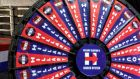"A prize wheel at the Republicans' base in Philadelphia taking entitled ""Hillary Clinton's Rigged System""."