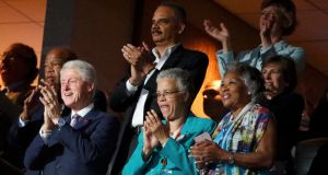 Former US president Bill Clinton applauds First Lady Michelle Obama's speech. Photograph: Lucy Nicholson/Reuters