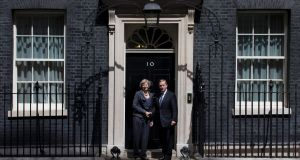 British prime minister Theresa May with Taoiseach Enda Kenny on the steps of 10 Downing Street. Photograph: Justin Tallis.AFP/Getty
