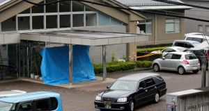 A hearse leaves a residential care facility for disabled people in Sagamihara, near Tokyo, where at least 19 people were killed and dozens injured in a knife attack on Tuesday. Photograph: Kimimasa Mayama/EPA