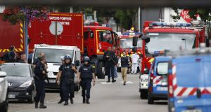 NORMANDY ATTACK: French police officers arrive at the scene of a hostage-taking at a church in Normandy, France. Photograph: Charly Triballeau/AFP/Getty Images