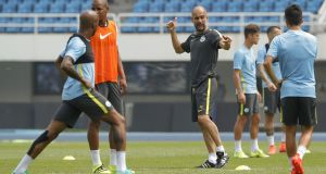 Manchester City's manager Pep Guardiola during pre-season training in Beijing. Photograph:  Lintao Zhang/Getty Images
