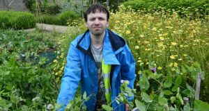 Darragh Smith in the walled garden in Marley Park, in Dublin. Photograph: Cyril Byrne