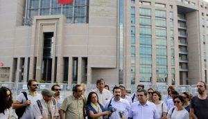 Journalists gather outside a court building in Istanbul to support their colleague journalist Bulent Mumay, who was detained on Tuesday in connection with the investigation launched into the failed coup attempt in Turkey on July 15th. Photograph: Petros Karadjias/AP