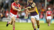 Cork's William Egan tackles Lee Chin of Wexford during round two of the All-Ireland Senior Hurling Championship qualifiers. Photo: Donall Farmer/Inpho