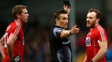 Watching his step: Cork's Brian O'Driscoll is black carded by referee Maurice Deegan during their league match against Mayo. Photograph: James Crombie/Inpho