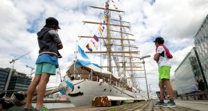 TALL SHIPS: Diego 8 and Patricio Appendino, 10, from the Docklands Dublin, at the Tall Ship Frigate ARA 'Libertad' in Dublin as part of Argentina's Navy 45th training trip. Photograph: Dara Mac Donaill/The Irish Times