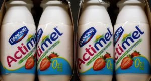 Danone, the world's largest yogurt maker, reported first-half earnings that beat analyst estimates as a revamp of its Actimel and Danonino brands and price increases offset lower-than-expected volume.