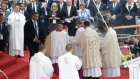 Pope Francis falls during event