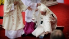 Pope Francis stumbles while saying mass in Poland