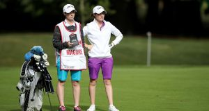 Ireland's Leona Maguire with her twin sister and caddie Lisa Maguire during day one of the Ricoh Women's British Open at Woburn Golf Club. Photo: Nick Potts/PA Wire