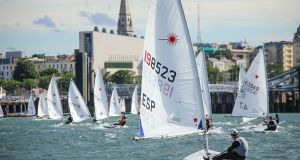 Laser Radial dinghies return to Dún Laoghaire harbour at the KBC World Championships. Photograph: David O'Brien