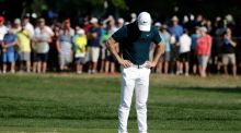 Rory McIlroy reacts after a missed putt on the 10th hole during the first round of the PGA Championship at Baltusrol Golf Club in Springfield, New Jersey. Photo: Jason Szenes/EPA