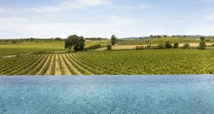 View from the infinity pool over vineyards at the Château St Pierre de Serjac
