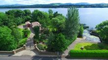 The four-bedroom single story home is on shores of Lough Derg on the River Shannon, surrounded by over an acre of garden